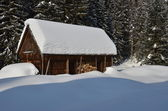 Old wooden building in winter — Stock Photo