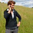 Stock Photo: Young womis calling