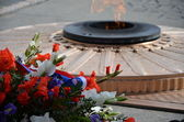 Eternal flame on grave of the unknown soldier — Stock Photo