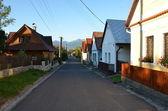 Village street at the sunset — Stock Photo