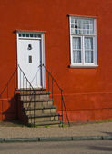 Red house entrance — Stock Photo
