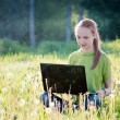 Girl with computer — Stockfoto