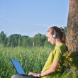 Girl with laptop in the country — Stock Photo