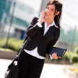 Young smiling businesswoman outdoors making a mobile phone call — Stock Photo