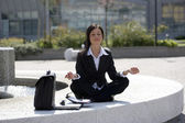 Young businesswoman take a break in a zen position — Stock Photo