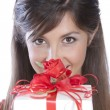 Romantic caucasian brunetee portrait behind a gift box — Stock Photo