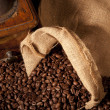 Top view close-up of coffe beans with juta bag and grinder — Stock Photo