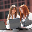 Two businesswoman working outdoors — Stock Photo #9766063
