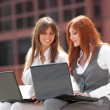 Two businesswoman working outdoors — Stock Photo