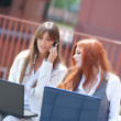 Two business woman working outdoors — Stock Photo