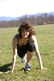Young woman doing phisycal activity in a park — Stockfoto