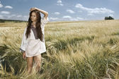 Portrait of pretty woman in the field — Stock Photo