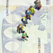 Stock Photo: Miniature queue twenty euros