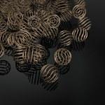 Stylish brass ring spheres background — Stock Photo #9932604