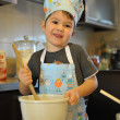 Small boy chef baking cake — Stock Photo