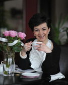 Relaxed businesswoman with cofffee — Stock fotografie