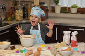 Small boy chef baking cake — Stock Photo