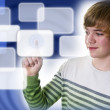 Boy with touch screen - Stock Photo