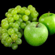Stock Photo: Apples and grapes on black background