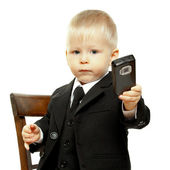 The boy in a suit has control over phone — Stock Photo