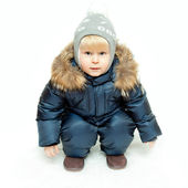 The boy in winter overalls — Stock Photo