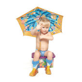 The boy under an umbrella sits on a box — Stock Photo