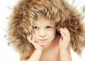 Little boy in a furry hood — Stock Photo