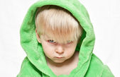 Serious boy in green dressing gown — Stock Photo