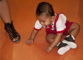 Kid looking at legs — Stock Photo