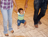 Young baby learning to walk — Stock Photo