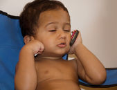 Baby on mobile — Stock Photo