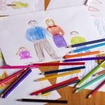 Child's hand is writing MAMA — Stock Photo