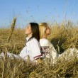 Young  women on a the field - Stock Photo