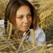 Portrait of a young women on a field — Stock Photo #10418582