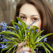 A girl young women with bunch of bluebells in spring forest — Stock Photo