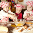 Three little chefs enjoying in the kitchen making big mess. Litt — 图库照片