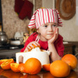 Little girl making fresh and healthy orange juice - Stock Photo