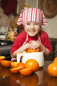 Little girl making fresh and healthy orange juice — Stock Photo