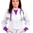 Young caring doctor or health care worker in white uniform, with — Stock Photo