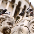 Group of pigeons on the statue — Stock Photo #9664260