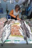 Seller at fish market — Stock Photo