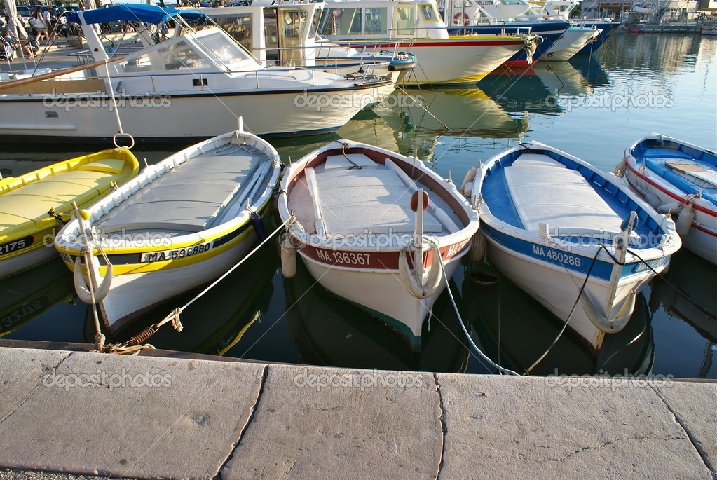 Small row boats on port side at sunset — Stock Photo #10201615