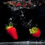 Strawberries Splashing Into Water — Stock Photo #9714984