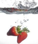 Strawberries Splashing Into Water — Stock Photo