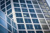 Blue glass office facade — Stock Photo