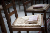 Bible on church chair — Stock Photo