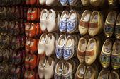 Wooden shoes Dutch souvenirs big choice — Stock Photo