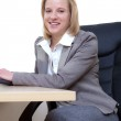 Portrait of pretty young business woman smiling — Stock Photo #10273227