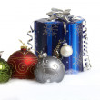 A red, green and silver christmas ball and a gift in the snow — Stock Photo