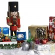 Christmas decoration with gifts, christmas balls, wooden sign and nutcracker — Foto Stock